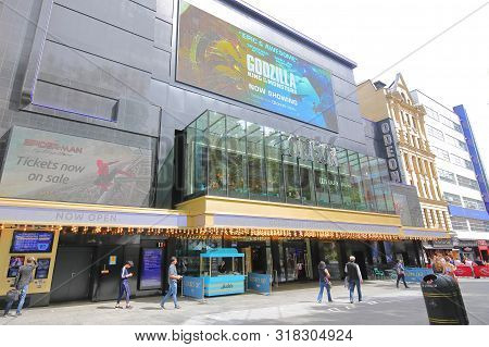 London England - June 1, 2019: Unidentified People Visit Odeon Movie Cinema Leicester Square London