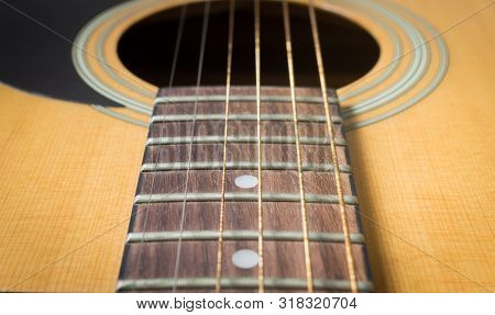 Fingerboard And Inlay And Old Acoustic Guitar String With Sound Hole And Pickguard