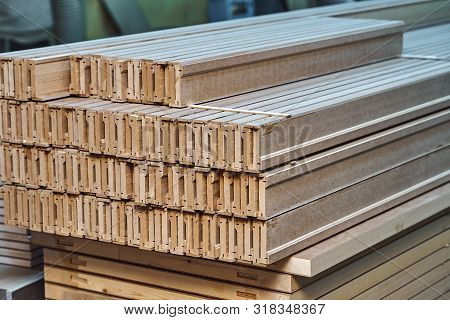 Joinery. Wood door manufacturing process. Stacked door leaf elements. Woodworking and carpentry production. Furniture manufacture. Close-up poster