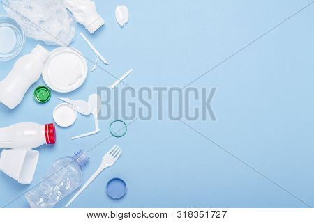 Garbage Collection, Plastic On A Blue Background. Concept Stop Plastic, Recycling, Separate Collecti