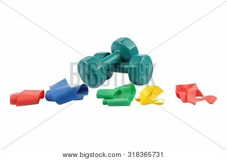 Colorful And Crisp Image Of Therapy Bands And Thigh Expander On White Background