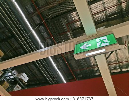 Emergency Exit Route Sign On Top Of Factory Warehouse