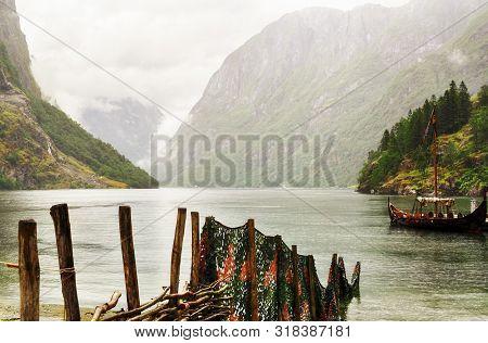 Foggy Summer Dag  At Naeroey Fjord  ( Unesco Words Heritage Site) In The Town Gudvangen, Norway