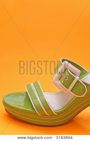 poster of A Green Woman's Summer Platform Shoe against bright background