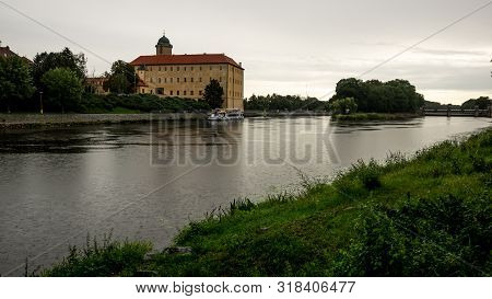 Podebrady Castle View From The Opposite Bank During Falling Rain