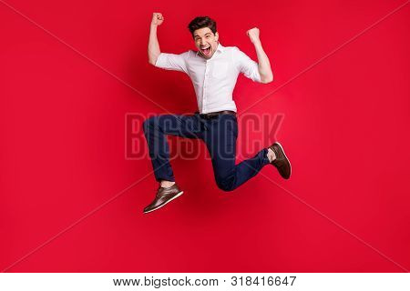 Photo Of Cheerful Overjoyed Excited Ecstatic Man Running With Happiness Of Having Reached His Goal W