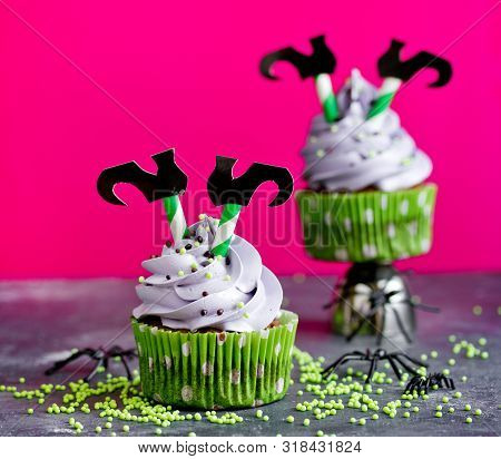 Halloween Witch Cupcakes Decorated With Cream And Witch Legs
