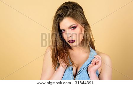Perfect makeup. Confident in her impeccable appearance. Makeup cosmetics concept. Feminine and glamorous. Attractive woman makeup face. Sensual fashion model sexy decollete. Dark lips and smoky eyes poster