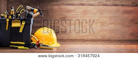 Safety Helmet With Tools In The Black Container