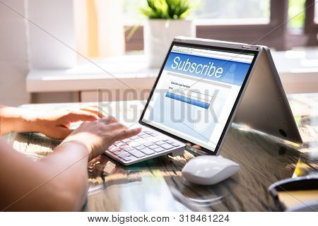 Laptop Showing Online Subscription Form On Screen