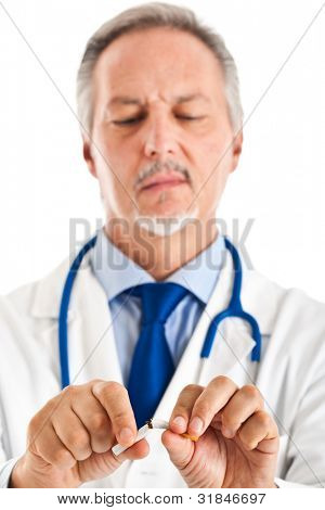 Closeup of a doctor's hands breaking a cigarette