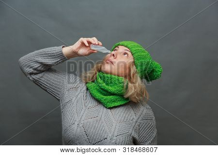 Cold. Portrait Of Beautiful Young Woman Sniffing Nasal Spray Closing One Nostril. Closeup Of Female