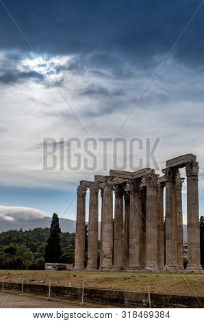 Temple Of Olympian Zeus, Athens, Greece With Dramatic Sky And Clouds