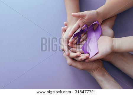 Adult And Child Hands Holding Purple Ribbons, Alzheimer's Disease, Pancreatic Cancer, Epilepsy Aware