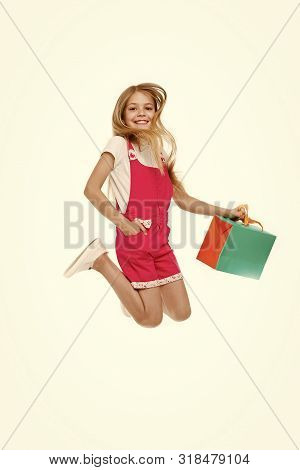 Finally Bought It. Girl Cute Teenager Carries Shopping Bag While Jumping. Sale Benefits. Kid Bought