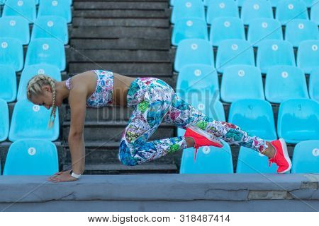 young caucasian young fitness woman is doing abs exercise