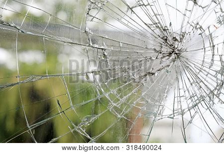 Old Cracked Dirty Broken Glass Window Background.