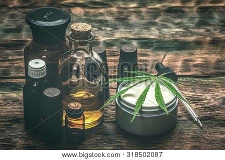 Cannabis Face Cream Or Moisturizer Jar And Cbd Oil Bottles Concept.