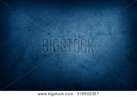 Closeup of blue textured background. Dark edges. Copy space