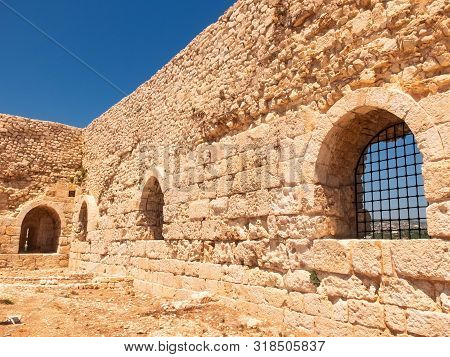 Ancient Fortress Walls With Embrasures And Metal Bars. Kizkalesi, Mersin Province, Turkey