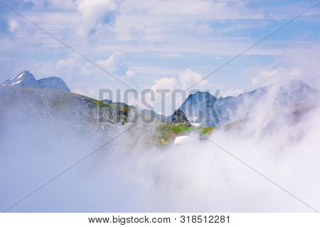 Stunning Scenery Of Cloud Formations In High Mountains Of Romania. Fagaras Ridge In Dynamic Weather