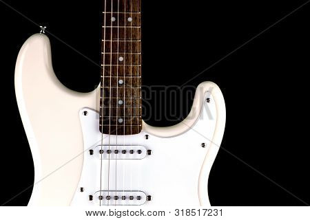 Electric Guitar Body And Fret Board Isolated Against A Black Background
