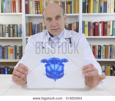 Psychotherapist holding Rorschach Test