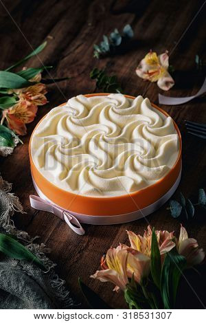 Cream Cake With Wave Pattern In An Orange Box