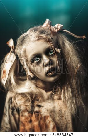 A portrait of a scary blonde zombie girl. Halloween. Horror film.