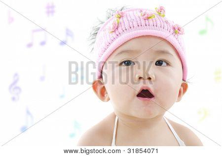 Little pan Asian girl singing happily