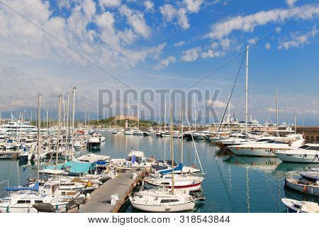 Boats in the harbor of Antibes with fort carre