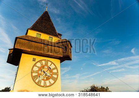 View At Famous Clock Tower Uhrturm At Schlossberg Hill. Travel Destination. Copy Space