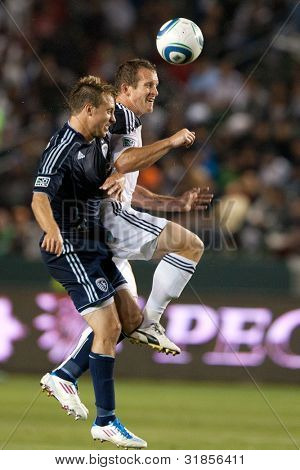 CARSON, CA. - MAY 14: Los Angeles Galaxy F Chad Barrett #11 (R) & Sporting Kansas City D Michael Harrington #2 (L) during the MLS game on May 14, 2011 at the Home Depot Center in Carson, CA.