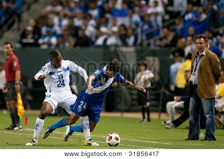 CARSON, CA. - JUNE 6: Honduras D Brayan Beckeles #24 (L) & Guatemala M Jonathan Lopez #24 (R) during the 2011 CONCACAF Gold Cup group B game on June 6, 2011 at the Home Depot Center in Carson, CA.