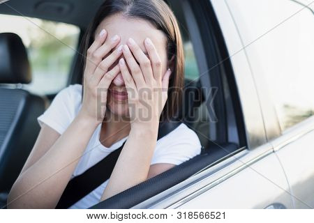 Stressed Woman Driver Sitting Inside Her Car