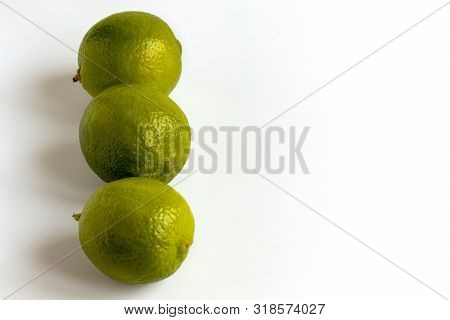 Green Lime Isolated. Whole Organic Citrus Fruit. Clipping Path Isolated on white Background. Fresh Limes Group for Citric Coctail or Lemonade. Juicy Vitamin Ingredient for Raw Vegetarian Food poster