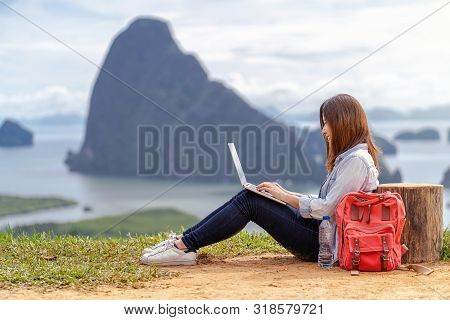 Asian Woman Freelancer Working With Technology Laptop With Happiness Action At Fantastic Landscape O