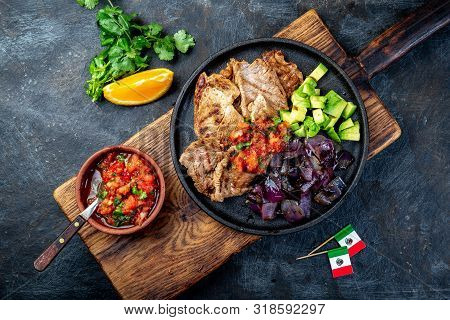 Yucatan Mexican Food Pork Poc Chuc Poc Chuck. Pork Marinaded In Orange Juice Served With Avocado, Pu