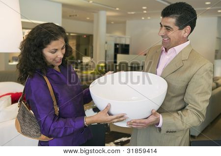 Couple Examining Large Bowl