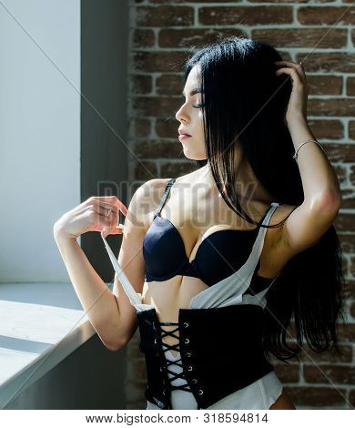 Sensual Girl Sexy Breasts Relaxing Near Windowsill. Attractive Female Sexy Lingerie At Home. Stunnin