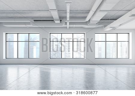poster of Spacious empty office in industrial style with white walls, concrete floor and large windows with cityscape. 3d rendering