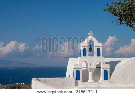 Church Bells On A Greek Orthodox Church Overlooking The Aegean Sea In The Town Of Oia On The Island
