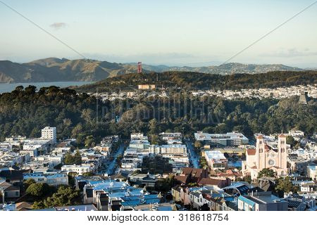 Low aerial view of Inner Sunset and Richmond districts of San Francisco with Golden Gate Bridge in Background