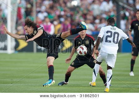 PASADENA, CA. - MAY 25: Mexico M Andres Guardado #18 (L) & United States F Freddy Adu #20 (R) during the 2011 CONCACAF Gold Cup championship game on May 25, 2011 at a sold out Rose Bowl in Pasadena, CA.