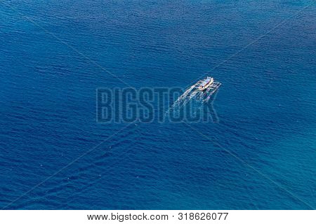 Aerial View From The Drone On A Boat Sailing On The Sea. Summer Vacation Concept.