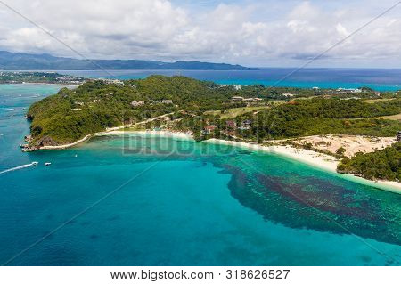 Aerial View From The Drone On The Landscape Tropical Sand Beach With Palm Trees And Turquoise Sea Wi