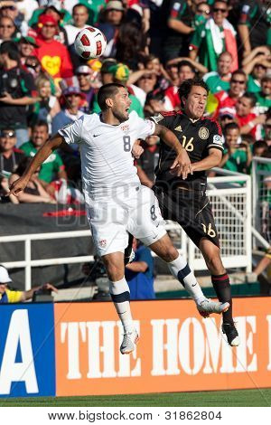 PASADENA, CA. - MAY 25: United States M Clint Dempsey #8 (L) & Mexico M Efrain Juarez #16 (R) during the 2011 CONCACAF Gold Cup championship game on May 25, 2011 at a sold out Rose Bowl in Pasadena, CA.