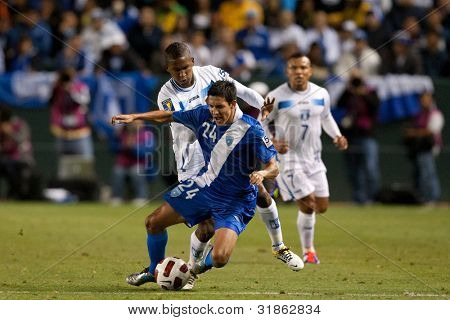 CARSON, CA. - JUNE 6: Honduras D Brayan Beckeles #24 (back) & Guatemala M Jonathan Lopez #24 (front) during the 2011 CONCACAF Gold Cup group B game on June 6, 2011 at the Home Depot Center in Carson, CA.