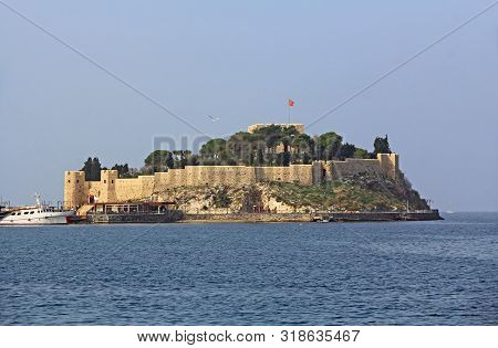 Güvercinada Or Pigeon Island Is A Peninsula In The Aegean Sea With A Pirate Castle Off The Coast Of