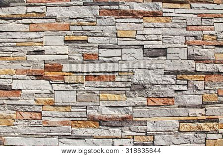 Multi-colored Red, Yellow, Orange And White Colorful Stone Wall Background Texture In Kusadasi, Turk
